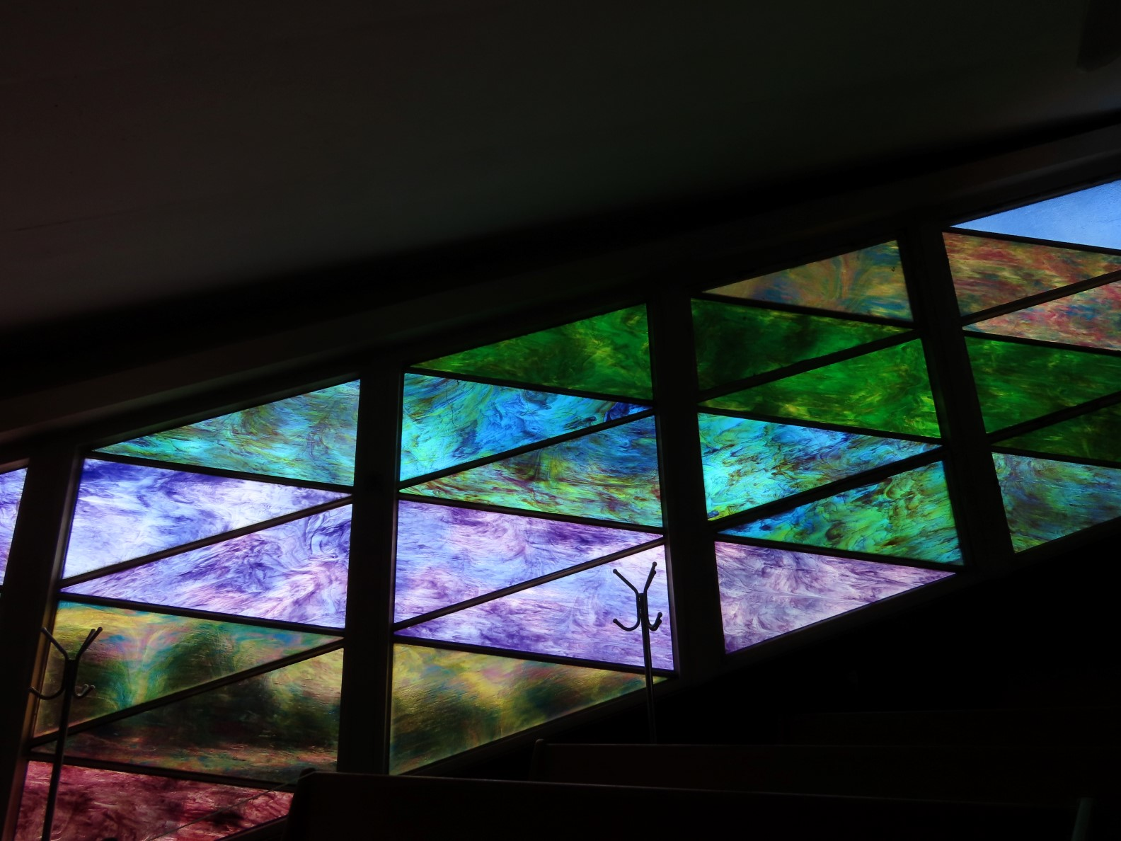 Stained glass windows. Green and purple.